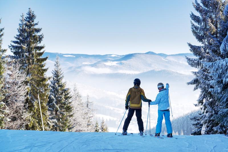 Couple of skiers on winter resort