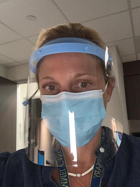 Nurse Navigator Testimonial | nurse in PPE